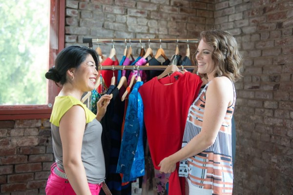 Catherine Cassidy of U*Styled helps a client assess some power outfit choices