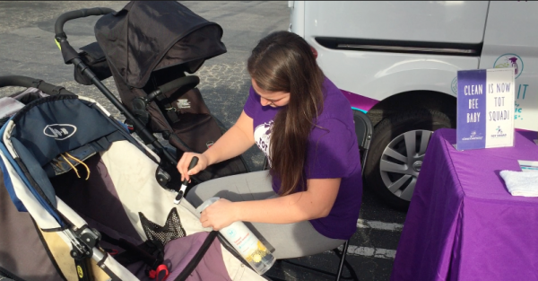 Tot Squad performing a professional stroller sanitization